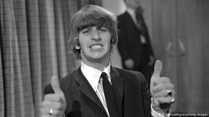 Drummer Ringo Starr, of 'The Beatles', with his thumbs up, June 12th 1964