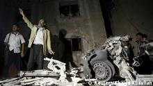 A man reacts as he stands next to wreckage at the site of a car bomb attack outside his house in Yemen's capital Sanaa June 29, 2015. A car bomb claimed by Islamic State exploded in the Yemeni capital Sanaa overnight, medics said, wounding at least 28 people gathered to mourn another attack earlier this month. REUTERS/Khaled Abdullah
