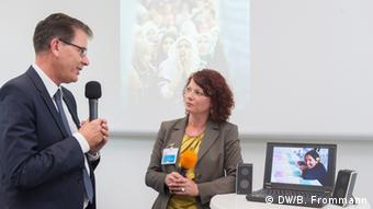 Germany's development minister speaks with Mirjam Gehrke, country coordinator for Ecuador (photo: Barbara Frommann).