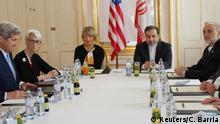 *30.06.2015 U.S. Secretary of State John Kerry (L) and U.S. Under Secretary for Political Affairs Wendy Sherman (2nd L) meet Iranian Foreign Minister Javad Zarif (2nd R) at a hotel in Vienna, Austria June 30, 2015. With a Tuesday deadline for a final nuclear deal with the United States and five other major powers set to be missed, Iran's foreign minister said he believed it was possible to get an agreement. REUTERS/Carlos Barria
