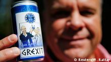 German entrepeneur Uwe Dahlhoff displays a can of the new Grexit energy drink, labelled with the caricatures of Greek Prime Minister Alexis Tsipras (R) and Finance Minister Yannis Varoufakis happily raising their glasses under a miserable-looking German Chancellor Angela Merkel in Hamm, western Germany, June 30, 2015. Dahlhoff is tapping into the bittersweet relations between Germany and Greece by patenting the name Grexit for a lemon vodka schnapps. The schnapps, available in 2cl and 100ml bottles, will be on sale soon at the price of from about 0.59 Euro cents. Words on label reads : 'even sour makes you happy' REUTERS/Wolfgang Rattay