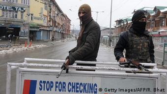 Indian policemen stand guard in Srinagar on January 26, 2014. India celebrated its 65th Republic Day under heavy security in the disputed territory, with mobile phone services suspended during the celebrations, and amid a strike by Kashmiri separatists opposed to Indian rule of Indian-administered Kashmir (Photo: ROUF BHAT/AFP/Getty Images)