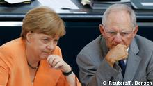 01.07.2015 **** German Chancellor Angela Merkel speaks with Finance Minister Wolfgang Schaeuble during a parliamentary debate on the Greek debt crisis at the German lower house of parliament Bundestag in Berlin, Germany, July 1, 2015. REUTERS/Fabrizio Bensch