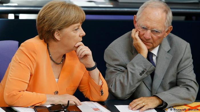 German Chancellor Angela Merkel speaks with Wolfgang Schäuble (Reuters/F. Bensch)