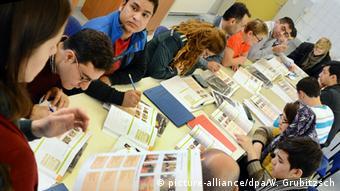Migrants learning German