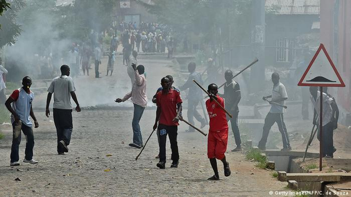 Imbonerakure militia seen amidst a crowd of smoke (Getty Images/AFP/C. de Souza)