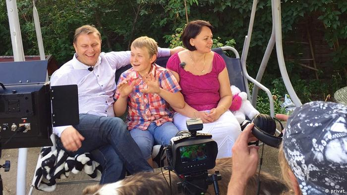 A picture of the Polish family of Dorota Dziubalko and her husband and son being interviewed for Norwegian TV.