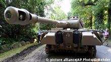 In this July 2, 2015 picture a World War II era Panther tank is prepared for transportation from a residential property in Heikendorf, northern Germany. Authorities have seized a 45-ton Panther tank, a flak canon and multiple other World War II-era military weapons in a raid on a 78-year-old collector's storage facility in northern Germany. Kiel prosecutor Birgit Hess said the collector is being investigated for possibly violating German weapons laws but his attorney Peter Gramsch told the dpa news agency all the items were properly demilitarized and registered. (Carsten Rehder/dpa via AP)