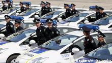 Police officers stand amidst cars before an oath-taking ceremony, which started up the work of a new police patrol service, part of the Interior Ministry reform initiated by Ukrainian authorities, in Kiev, Ukraine, July 4, 2015. The new service, which includes road, metro and foot patrols, is expected to replace the traffic police, widely associated with disrepute and corruption, according to local media. First 2.000 officers took an oath of allegiance to the Ukrainian people on Saturday. REUTERS/Valentyn Ogirenko TPX IMAGES OF THE DAY