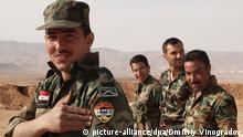 2599706 03/27/2015 A Syrian army soldier shows a patch with a portrait of Syrian President Bashar al-Assad on the Syrian-Lebanese border 60 km north-west of Damascus. Dmitriy Vinogradov/RIA Novosti