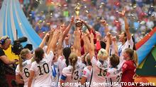 05.07.2015 ***Jul 5, 2015; Vancouver, British Columbia, CAN; United States players react as they receive the FIFA Women's World Cup trophy after defeating Japan in the final of the FIFA 2015 Women's World Cup at BC Place Stadium. The United States won 5-2. Mandatory Credit: Anne-Marie Sorvin-USA TODAY Sports