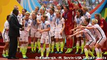 05.07.2015 ***Jul 5, 2015; Vancouver, British Columbia, CAN; United States players are presented with the FIFA Women's World Cup trophy after defeating Japan in the final of the FIFA 2015 Women's World Cup at BC Place Stadium. The United States won 5-2. Mandatory Credit: Anne-Marie Sorvin-USA TODAY Sports