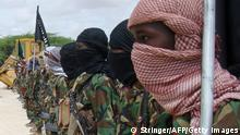 Militants belonging to Somalia�s Al-Qaeda-inspired Shebab Islamists stand in formation on October, 21, 2010 during a show of force in Somalia's capital Mogadishu. A Briton held hostage for close to a week in Somalia flew out of the country and was headed for Kenya on Octobner 21, a day after being released by his captors, AFP PHOTO/STRINGER (Photo credit should read STRINGER/AFP/Getty Images)