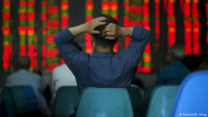 An investor follows share prices in Shanghai, China