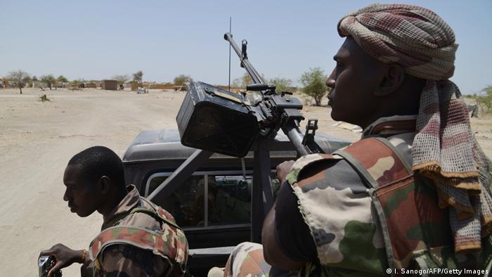 Nigerien soldiers patrol the border between Niger and Nigeria