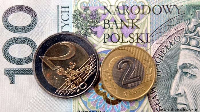 A euro coin and zlotys