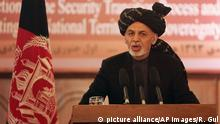 Afghan President Ashraf Ghani speaks during a ceremony marking the completion of security transition to Afghan security forces in Kabul, Thursday, Jan. 1, 2015. Afghan police are investigating a rocket strike on a wedding party that killed at least 28 people, many of them women and children, an official said Thursday, as President Ashraf Ghani marked the country?s transition to full sovereignty after the 13-year international military mission to rid Afghanistan of insurgents officially ended. (AP Photo/Rahmat Gul)