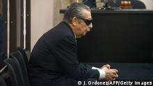 Former Guatemalan de facto President (1982-1983), retired General Jose Efrain Rios Montt, 86, is seen wearing dark glasses prescribed after his cataract surgery during a court hearing in Guatemala city on November 19, 2013.A tribunal confirmed that the trial for genocide against Rios Montt will begin in January 2015, after rejecting an appeal from the defendat. AFP PHOTO Johan ORDONEZ (Photo credit should read JOHAN ORDONEZ/AFP/Getty Images)