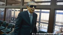 Former Guatemalan de facto President (1982-1983), retired General Jose Efrain Rios Montt, 86, is seen wearing dark glasses prescribed after his cataract surgery during a court hearing in Guatemala city on November 19, 2013. A tribunal confirmed that the trial for genocide against Rios Montt will begin in January 2015, after rejecting an appeal from the defendant. AFP PHOTO Johan ORDONEZ (Photo credit should read JOHAN ORDONEZ/AFP/Getty Images)