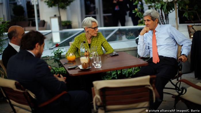 U.S. Secretary of State John Kerry, right, U.S. Under Secretary for Political Affairs Wendy Sherman, center, National Security Council point person on the Middle East Robert Malley, and Chief of Staff Jon Finer, front, meet on the terrace of a hotel where the Iran nuclear talks meetings are being held in Vienna, Austria.