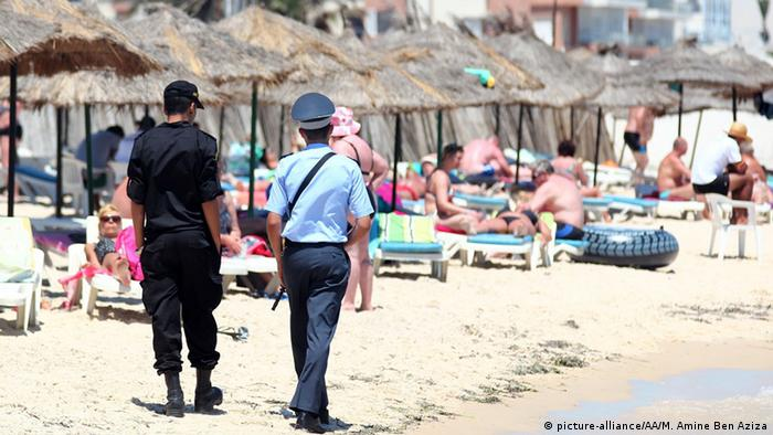Tunisian police patrol the beach