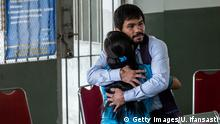 10.7.2015 YOGYAKARTA, INDONESIA - JULY 10: Filipino boxing icon Manny Pacquiao hugs convicted drug trafficker Mary Jane Veloso of the Philippines during a visit at Wirogunan prison on July 10, 2015 in Yogyakarta, Indonesia. Veloso was sentenced to death after being arrested in Adisucipto International Airport in Yogyakarta with 2.6kg of heroin. Pacquiao will meet with Indonesian President Joko Widodo in support of Veloso, who maintains her innocence. (Photo by Ulet Ifansasti/Getty Images)