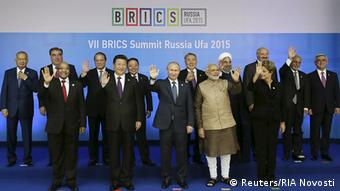 South Africa's President Jacob Zuma, China's President Xi Jinping, Russia's President Vladimir Putin, India's Prime Minister Narendra Modi, Brazil's President Dilma Rousseff and leaders of the invited states (2nd row L-R) Uzbek's President Islam Karimov, Tajikistan's President Imomali Rakhmon, Pakistan's Prime Minister Nawaz Sharif, Mongolia's President Tsakhia Elbegdorj, Kazakh's President Nursultan Nazarbayev, Iran's President Hassan Rouhani, Belarus's President Alexander Lukashenko, Afghanistan's President Ashraf Ghani and Armenia's President Serzh Sargsyan pose during a family photo session at the BRICS Summit in Ufa, Russia, July 9, 2015 (Photo: REUTERS/BRICS/SCO Photohost/RIA Novosti)