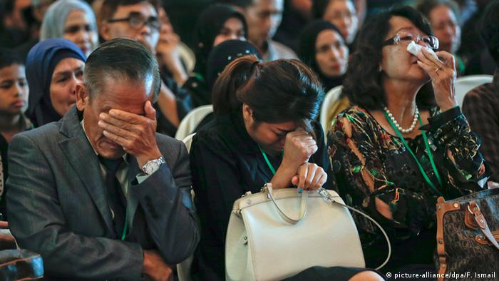 Families in Malaysia at a ceremony for victims