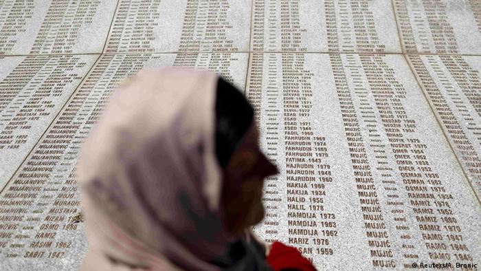 A woman stands in front of the Memorial Center near Srebrenica