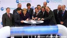 Ex-Bundeskanzler Gerhard Schröder (l-r), der französische Premierminister François Fillon, der Vorstandsvorsitzende der E.ON AG, Johannes Teyssen, Bundeskanzlerin Angela Merkel (CDU), der niederländische Ministerpräsident Mark Rutte, der russische Staatspräsident Dmitri Medwedew, Gazprom-Manager Alexei Miller, der EU-Kommissar für Energie, Günter Oettinger, der BASF-Vorstandsvorsitzende Kurt Bock, Mecklenburg-Vorpommerns Ministerpräsident Erwin Sellering (SPD), der Geschäftsführer des deutsch-russischen Gas-Pipeline-Konsortiums (Nord Stream AG); Matthias Warnig, und der Geschäftsführer der Nederlandse Gasunie, Paul van Gelder (l-r) eröffnen am Dienstag (08.11.2011) mit einem symbolischen Akt die Ostsee-Pipeline Nord Stream in Lubmin. Die rund 7,4 Milliarden Euro teure Pipeline des russisch-europäischen Konsortiums Nord Stream verbindet Deutschland und Westeuropa direkt und unter Umgehung von Transitländern mit einem der größten Erdgasfelder der Welt. Gaslieferant ist der russische Energiekonzern Gazprom, der mit 51 Prozent auch Mehrheitseigner der Nord Stream AG ist. Foto: Stefan Sauer dpa/lmv +++(c) dpa - Bildfunk+++