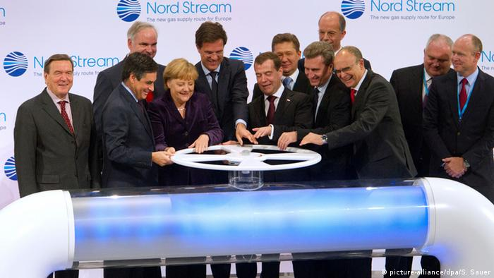 German and Russian officials turnt he spigot to begin the flow of gas through the Nord Stream pipeline.