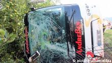 Firemen work near the bus goes off the road on A22 highway at Trento north exit in Trento, nothern Italy, 12 July 2015. At last 17 injuried after a bus filled with German teenagers heading home from vacation has run off a highway in Trento, northern Italy 12 July 2015. ANSA/STR (Zu dpa Bus mit deutschen Jugendlichen in Italien verunglückt vom 12.07.2015)