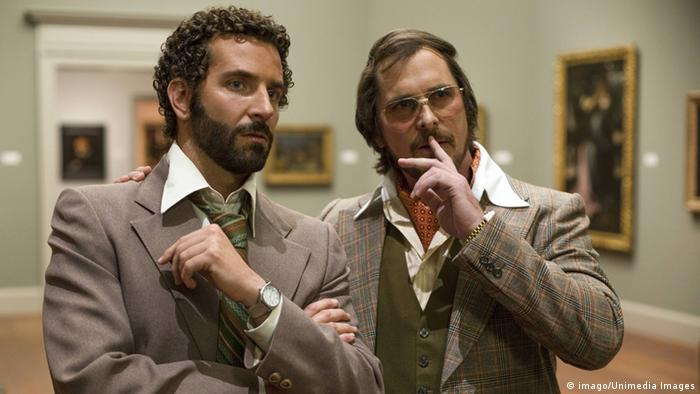 Film still 'American Hustle' with Bradly Cooper and Christian Bale (Photo: imago/Unimedia Images)