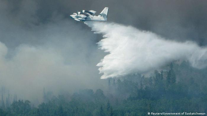 Water bomber dropping water on a forest. (Photo: REUTERS/Government of Saskatchewan)