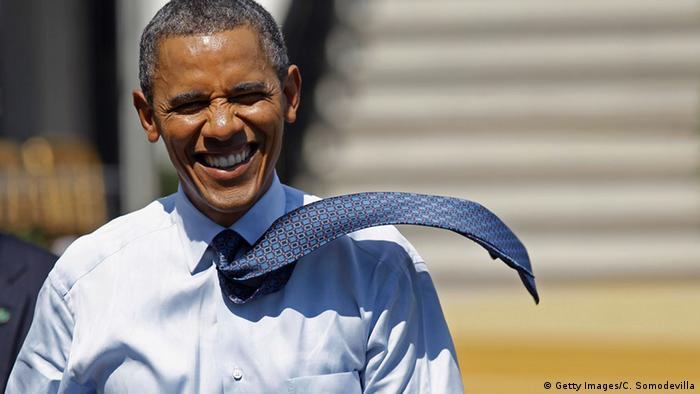Barack Obama with his tie blowing in the wind