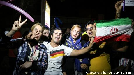 Iranians celebrate the deal