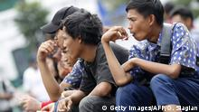 An Indonesian youth smokes a clove cigarette in Jakarta on April 7, 2012. The World Trade Organization on April 4 threw out Washington's appeal against Jakarta's claim that US rules banning the sale of Indonesian clove cigarettes infringed international trade rules. AFP PHOTO/ OSCAR SIAGIAN (Photo credit should read OSCAR SIAGIAN/AFP/Getty Images)