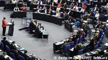 17.07.2015+++ German Chancellor Angela Merkel (L) gives a speech during a special session at the Bundestag (lower house of parliament) in Berlin on July 17, 2015. German lawmakers rally to vote on a new Greece bail-out deal, two days after the parliament in Athens grudgingly agreed to harsh reforms. AFP PHOTO / TOBIAS SCHWARZ (Photo credit should read TOBIAS SCHWARZ/AFP/Getty Images)