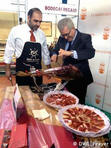 Spanish ham being sliced.