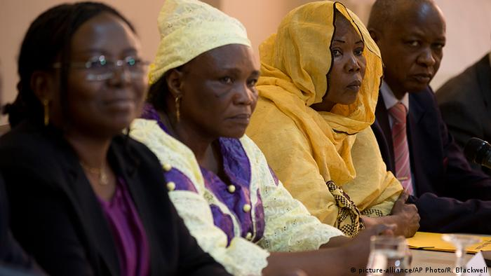 Victims of former Chadian dictator Hissene Habre sit alongside Chadian lawyer Delphine Djiraibe, left, during a press conference in Dakar, Senegal, (AP Photo/Rebecca Blackwell)