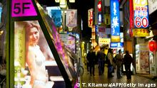 TOKYO, JAPAN: A neon sign of pub advert showing a portait of a woman is displayed at the Tokyo's Kabukicho area 22 February 2002. Kabukicho an area of flashing neon lights and pounding music, is still packed with hostess bars, sex clubs, massage parlours, and strip joints, but the nightly crowd of drunken businessmen are gone. AFP PHOTO / TOSHIFUMI KITAMURA (Photo credit should read TOSHIFUMI KITAMURA/AFP/Getty Images)