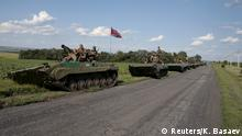 17.7.2015 An armored column of the self-proclaimed Donetsk People's Republic forces is seen on the roadside near the site of the Malaysia Airlines flight MH17 plane crash outside the village of Hrabove in Donetsk region, Ukraine, July 17, 2015. The rebel-held east Ukrainian village where a Malaysian airliner was shot down honored the 298 victims at a simple ceremony on Friday as calls grew for an international tribunal to prosecute those who brought it down. After a church service in the village of Hrabove, residents joined a procession across an open field to a gravestone placed near the charred area where twisted metal and body parts came crashing down on July 17 last year. REUTERS/Kazbek Basaev