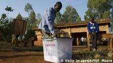 A man casts his vote at an open air polling station