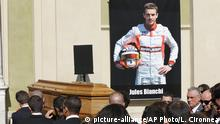 Pallbearers carry the casket of French Formula One driver Jules Bianchi into Sainte Reparate Cathedral during his funeral in Nice, French Riviera, Tuesday, July 21, 2015. Bianchi, 25, died Friday from head injuries sustained in a crash at last year's Japanese Grand Prix. He had been in a coma since the Oct. 5 accident, in which he collided at high speed with a mobile crane which was being used to pick up another crashed car. (AP Photo/Lionel Cironneau)