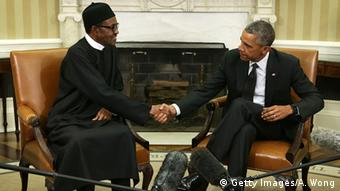 President Buhari and President Obama shake hands in the Oval Office at the White House