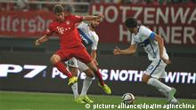 Andrea Ranocchia of Inter Milan, right, challenges Thomas Muller of Bayern Munich during a friendly match between Bayern Munich and Inter Milan in Shanghai, China, 21 July 2015. Bayern Munich defeated Inter Milan 1-0 during a friendly match for the Audi Football Summer Tour China 2015 in Shanghai, China, on Tuesday (21 July 2015).