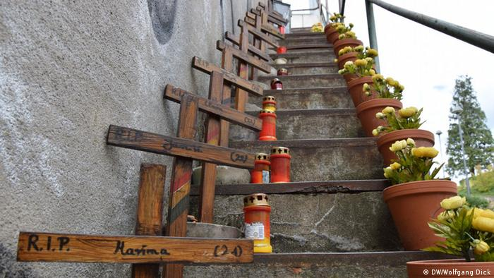 steps leading up, with crosses and candles