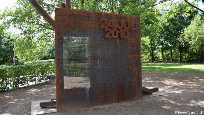 rusted memorial plaque