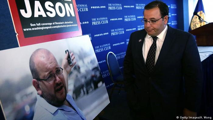 Ali Rezaian looks at a picture of his brother, Washington Post Tehran bureau chief Jason Rezaian