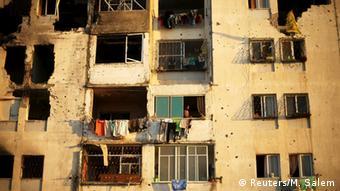 Разрушенное здание в секторе Газа